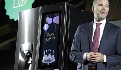David VanderWaal, vice president of marketing for LG Electronics USA, unveils the LG InstaView Door-in-Door refrigerator during an LG news conference before CES International, Wednesday, Jan. 4, 2017, in Las Vegas. (AP Photo/John Locher)