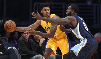 Los Angeles Lakers guard Nick Young, left, tries to pass the ball while under pressure from Memphis Grizzlies forward JaMychal Green during the first half of an NBA basketball game, Tuesday, Jan. 3, 2017, in Los Angeles. (AP Photo/Mark J. Terrill)