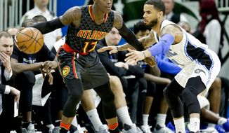 Atlanta Hawks' Dennis Schroder (17), of Germany, looks for a way past Orlando Magic's D.J. Augustin during the first half of an NBA basketball game, Wednesday, Jan. 4, 2017, in Orlando, Fla. (AP Photo/John Raoux)