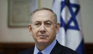 FILE -- In this Sunday, Dec. 25, 2016 file photo, Israeli Prime Minister Benjamin Netanyahu attends a weekly cabinet meeting in Jerusalem. On Wednesday, Jan. 5, 2017, Netanyahu called for a pardon for a soldier convicted of manslaughter in the shooting death of a badly wounded Palestinian assailant. With his comment, the prime minister has plunged into a raging political debate that has divided the country and put himself at odds with the military. Sgt. Elor Azaria was convicted on Wednesday of manslaughter in the fatal shooting of a Palestinian who lay on the ground incapacitated from shots sustained after he stabbed and wounded a soldier in the volatile West Bank city of Hebron. (Dan Balilty/Pool photo via AP, File)