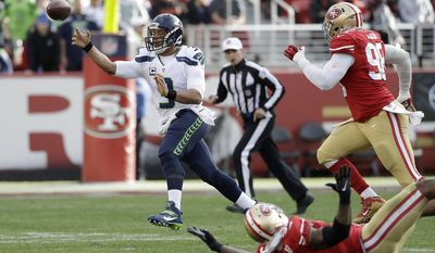 FILE  - In this Sunday, Jan. 1, 2017, file photo, Seattle Seahawks quarterback Russell Wilson (3) passes against the San Francisco 49ers during the first half of an NFL football game in Santa Clara, Calif. Wilson isn't running like he used to due in part to ankle and knee injuries. The Detroit Lions, though, are preparing for Seattle's quarterback to be at his best on his feet Saturday night. (AP Photo/Marcio Jose Sanchez, File)