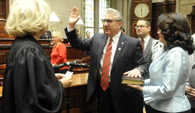 New York Court of Appeals Chief Judge Janet DiFiore, left, swears in newly elected Sen. James Tedisco, R-Glenville, as his son Andrew Tedisco, center, and wife Mary Tedisco right, look on during a ceremony in the Senate Chamber at the Capitol on the opening day of the legislative session on Wednesday, Jan. 4, 2017, in Albany, N.Y. (AP Photo/Hans Pennink)