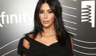 FILE - In this May 16, 2016 file photo, Kim Kardashian West attends the 20th Annual Webby Awards in New York. Kardashian West returned to social media on Tuesday, Jan. 3, 2017, three months after going silent in the wake of being held up and robbed of millions in jewelry at a Paris hotel.  (Photo by Andy Kropa/Invision/AP, File)