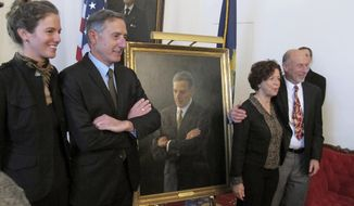 Outgoing Vermont Gov. Peter Shumlin, second from left, stands in front of his official portrait at the Statehouse in Montpelier, Vt., on Wednesday Jan. 4, 2017. To the left of Shumlin his is wife Katie Hunt. To the right of the photo is portrait artist August Burns and her husband Elliot Burg. (AP Photo/Wilson Ring)