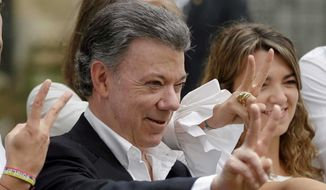 President Juan Manuel Santos won the Nobel Peace Prize for his efforts to halt the country's long civil war, but Colombians still distrust his peace treaty with the FARC rebels. (Associated Press)