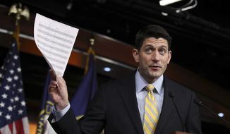 House Speaker Paul Ryan of Wis. holds his copy of insurance premium statistics during a news conference on Capitol Hill in Washington, Thursday, Jan. 5, 2017. (AP Photo/Manuel Balce Ceneta)