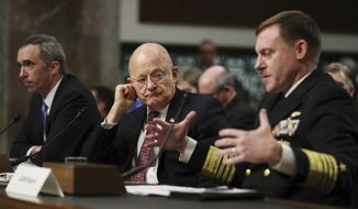"""U.S. Cyber Command Commander, National Security Agency Director, Central Security Services Chief Adm. Michael Rogers, right, accompanied by Director of National Intelligence James Clapper, center, and Defense Undersecretary for Intelligence Marcel Lettre II, testifies on Capitol Hill in Washington, Thursday, Jan. 5, 2017, before the Senate Armed Services Committee hearing: """"Foreign Cyber Threats to the United States."""" (AP Photo/Manuel Balce Ceneta)"""