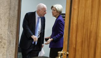 "Senate Armed Services Committee Chairman Sen. John McCain, R-Ariz., left, talks with Sen. Elizabeth Warren, D-Mass. on Capitol Hill in Washington, Thursday, Jan. 5, 2017, prior to the start of the committee's hearing: ""Foreign Cyber Threats to the United States.""  (AP Photo/Evan Vucci)"