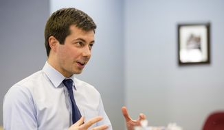 In this Wednesday, Jan. 4, 2017, photo, South Bend, Ind., Mayor Pete Buttigieg talks to a South Bend Tribune reporter regarding interest in the Democratic National Committee chairman position, inside the St. Joseph County Democratic Party headquarters in South Bend, Ind. Buttigieg announced his chairman candidacy Thursday, Jan. 5. (Robert Franklin/South Bend Tribune via AP)