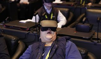 Han Chen reacts as he participates in a virtual realty presentation during an Intel news conference before CES International, Wednesday, Jan. 4, 2017, in Las Vegas. (AP Photo/John Locher)