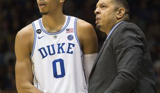 Duke assistant coach Jeff Capel, right, speaks with Duke's Jayson Tatum (0) during the second half of an NCAA college basketball game against Georgia Tech in Durham, N.C., Wednesday, Jan. 4, 2017. Duke defeated Georgia Tech 110-57. (AP Photo/Ben McKeown)
