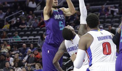 Charlotte Hornets guard Nicolas Batum shoots over Detroit Pistons guard Kentavious Caldwell-Pope during the second half of an NBA basketball game, Thursday, Jan. 5, 2017, in Auburn Hills, Mich. (AP Photo/Carlos Osorio)