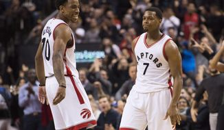 Toronto Raptors guard Kyle Lowry (7) and teammate DeMar DeRozan (10) celebrate against the Utah Jazz during the second half of an NBA basketball game, Thursday, Jan. 5, 2016 in Toronto. (Nathan Denette/The Canadian Press via AP)