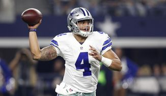 FILE - In this Dec. 26, 2016, file photo, Dallas Cowboys' Dak Prescott (4) throws a pass in the first half of an NFL football game against the Detroit Lions, in Arlington, Texas. The Cowboys next game is in the divisional playoffs on Sunday, Jan. 15. (AP Photo/Brandon Wade, File)