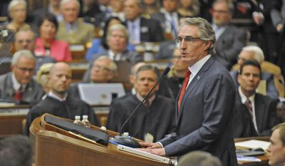 """Gov. Doug Burgum opens North Dakota's 65th legislative assembly on Tuesday, Jan. 3, 2017,  in front of a joint session of the legislature where he delivered the State of the State address, in Bismarck, N.D. Burgum touched on a number of topics in the address but a continuing theme was lifelong education. """"Learning begins with humility. Everyone has something to teach us,"""" he said. (Tom Stromme  /The Bismarck Tribune via AP)"""