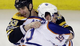 Boston Bruins defenseman Zdeno Chara (33) fights with Edmonton Oilers left wing Patrick Maroon (19) in the first period of an NHL hockey game, Thursday, Jan. 5, 2017, in Boston. (AP Photo/Elise Amendola)