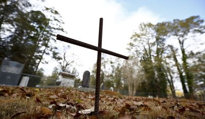 In this photo taken Dec. 6, 2016, a cross is shown where Les Johnson, 69, of Camden, Ala., a family friend of Attorney General-designate, Sen. Jeff Sessions, R-Ala. says Sessions's parents were buried at the Bell's Landing Presbyterian Church cemetery in Bell's Landing, Ala. (AP Photo/Brynn Anderson)