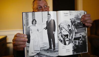 "In this photo taken Dec. 6, 2016, Les Johnson, 69, of Camden, Ala.,, a family friend of Attorney General-designate, Sen. Jeff Sessions, R-Ala. holds up a 1965 year book of Sessions graduating year as the Wilcox County High School's ""Senior High Who's Who, Mr. Wilcox County High,"" as appearing on the left page, an honor of the high school according to Alford in Camden, Ala. (AP Photo/Brynn Anderson)"