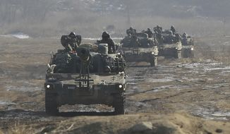 FILE - In this Jan. 11, 2015 file photo, South Korean army K-55 self-propelled artillery vehicles move during a military exercise near the demilitarized zone between the two Koreas in Paju, South Korea. South Korea will form a special military unit this year tasked with removing North Korea's leadership in the event of war as Seoul looks for options to counter its rival's nuclear weapons and missiles, an official said Thursday, Jan. 5, 2017. (AP Photo/Ahn Young-joon. File)