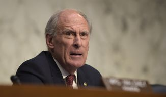 In this Nov. 17, 2016, file photo, then-Indiana Sen. Dan Coats on Capitol Hill in Washington. President-elect Donald Trump is planning to appoint former Coats as Director of National Intelligence. (AP Photo/Susan Walsh, File) **FILE**