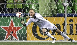 FILE - In this Oct. 30, 2016, file photo, Seattle Sounders goalkeeper Stefan Frei makes a stop against FC Dallas in the second half of an MLS soccer playoff match, in Seattle. Frei and Vancouver midfielder Kekuta Manneh, both in the process of completing U.S. citizenship requirements, are among 32 players who will report to the first U.S. training camp since Bruce Arena replaced Jurgen Klinsmann as coach. (AP Photo/Ted S. Warren, File)