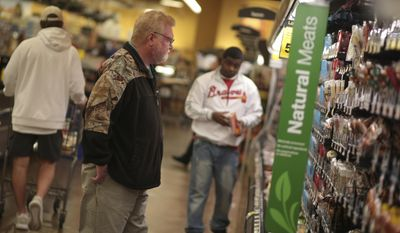 Danny Morgan, left, shops at Kroger located off of Alps Rd. in Athens, Ga., Thursday, Jan. 5, 2017. Forecasters are calling for 1-3 inches of snow throughout the weekend in the area. Winter storm watches Thursday covered large parts of Georgia, Alabama and the Carolinas ahead of the storm system that threatens to spread a wintry mix of rain, sleet and snow across the region.  (John Roark/Athens Banner-Herald via AP)