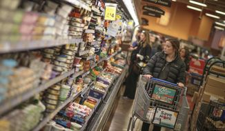 Lindsey Hodges shops at Kroger located off of Alps Rd. in Athens, Ga., Thursday, Jan. 5, 2017. A menacing winter storm approaching the South could bring freezing rain to states as far south as Louisiana, Mississippi and Alabama and up to 8 inches of snow in parts of North Carolina and Virginia, forecasters said. The storm also brings the threat of freezing rain to parts of the Deep South including Mississippi, Alabama and Georgia. (John Roark/Athens Banner-Herald via AP)