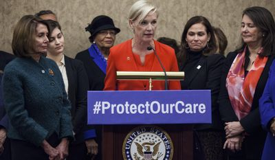 Planned Parenthood president Cecile Richards, joined by House Minority Leader Nancy Pelosi of Calif., left, and Rep. Diana DeGette, D-Colo., right, and others, speaks during a news conference discussing women's health care, Thursday, Jan. 5, 2017, on Capitol Hill in Washington. (AP Photo/Zach Gibson)