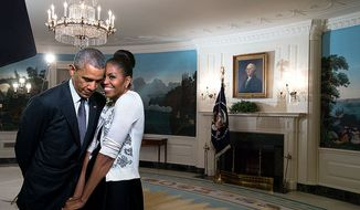 President Obama and his wife Michelle snuggle at the White House in this White House photo.