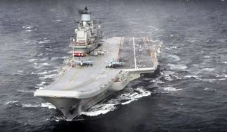 In this photo made from the footage taken from Russian Defense Ministry official web site on Wednesday, Jan. 4, 2017, the Admiral Kuznetsov aircraft carrier during its mission in the eastern Mediterranean Sea. Russia says it is withdrawing the Admiral Kuznetsov aircraft carrier and some other warships from the waters off Syria as the first step in drawing down forces in Syria. (File, Russian Defense Ministry Press Service/ Photo via AP)