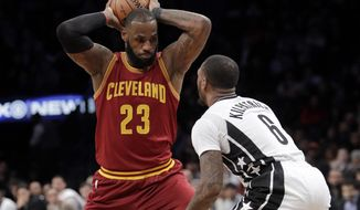 Brooklyn Nets' Spencer Dinwiddie (8) defends against Cleveland Cavaliers' LeBron James (23) during the first half of an NBA basketball game Friday, Jan. 6, 2017, in New York. (AP Photo/Frank Franklin II)