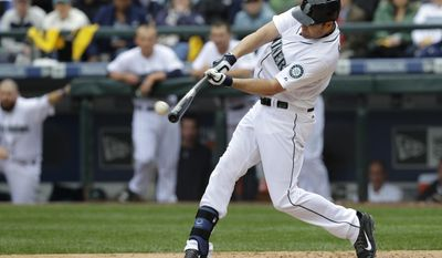 FILE - In this April 6, 2015, file photo, Seattle Mariners' Seth Smith hits an RBI triple in the third inning against the Los Angeles Angels in an opening day baseball game, in Seattle. The Mariners landed another option for their pitching rotation on Friday, Jan. 6, 2017, acquiring right-handed pitcher Yovani Gallardo from the Baltimore Orioles for outfielder Seth Smith.(AP Photo/Ted S. Warren, File)