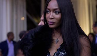 """FILE - In this Oct. 21, 2016, file photo, model Naomi Campbell, center, arrives at a BET event hosted by President Barack Obama and first lady Michelle Obama on the South Lawn of the White House, in Washington. Campbell revealed that she was the victim of a 2012 attempted robbery in Paris during an appearance on """"The Wendy Williams Show"""" Thursday, Jan. 5, 2016. (AP Photo/Carolyn Kaster, File)"""
