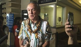 In this photo taken Wednesday, Jan. 4, 2017, Honolulu Police Commission Chairman Max Sword talks to reporters in Honolulu. The commission continued their closed door talks Friday on the status of Chief Louis Kealoha, who is on paid leave because he's the target of a federal investigation. (AP Photo/Jennifer Sinco Kelleher).