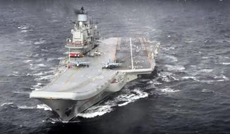 FILE - In this photo made from the footage taken from Russian Defense Ministry official web site on Wednesday, Jan. 4, 2017, the Admiral Kuznetsov aircraft carrier during its mission in the eastern Mediterranean Sea. Russia says it is withdrawing the Admiral Kuznetsov aircraft carrier and some other warships from the waters off Syria as the first step in drawing down forces in Syria. (File, Russian Defense Ministry Press Service/ Photo via AP)