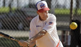 In this Dec. 13, 2016 photo, 97-year-old Winchell Smith takes a swing at the ball during a Kids & Kubs softball game in St. Petersburg, Fla. The Kids & Kubs is a Depression Era creation, beginning in the 1930's. All players in the league are over 75-years of age. (AP Photo/Chris O'Meara)