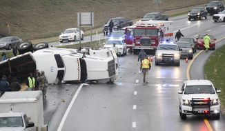 A tractor-trailer turned over on Interstate 20 West blocking both westbound lanes right before the Indiana Avenue Overpass in Vicksburg, Miss., Friday, Jan. 6, 2017. The incident involved one vehicle and the driver was transported away for medical care. (Courtland Wells/Vicksburg Post, via AP)