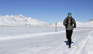 "In this Thursday, Jan. 4, 2017 photo, Walt Gerald braves sub-zero temperatures during his run at the National Elk Refuge near Jackson, Wyo. ""It's really not that bad once you get warmed up,"" Gerald said. ""The ice on my face is a nice wind block."" (Rugile Kaladyte/Jackson Hole News & Guide via AP)"