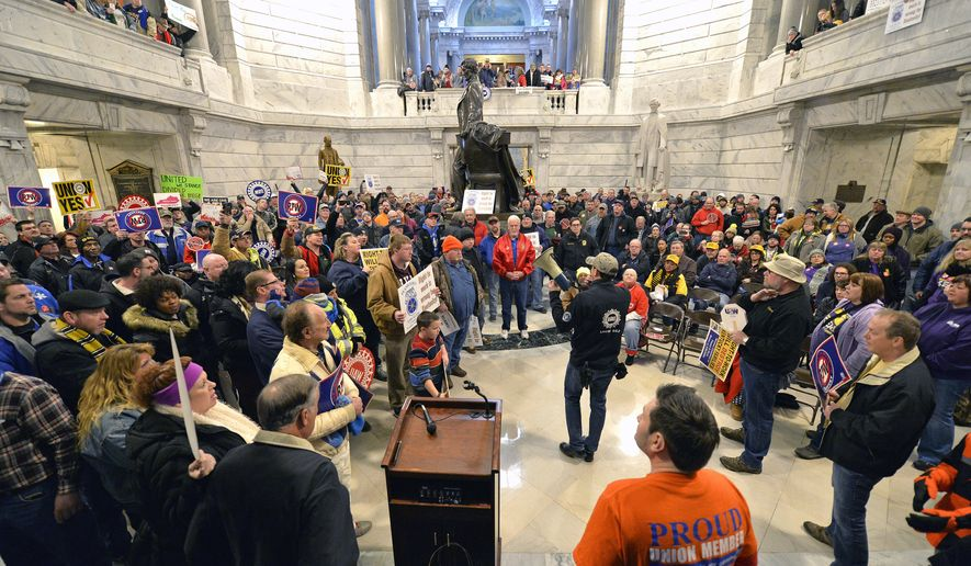 Union leaders speak to the protesters that fill the Kentucky Capitol rotunda in protest of Kentucky House Bill 1, Saturday, Jan. 7, 2017, in Frankfort, Ky. The bill, making it illegal for workers to have to join a labor union or pay dues to keep a job, was passed by the Senate, and now awaits the Governor's signature. (AP Photo/Timothy D. Easley)