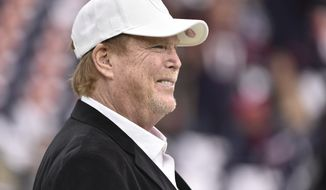 Raiders owner Mark Davis watches teams warm up before the first half of an AFC Wild Card NFL game between the Houston Texans and the Oakland Raiders, Saturday, Jan. 7, 2017, in Houston. (AP Photo/Eric Christian Smith)