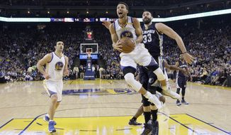 Golden State Warriors' Stephen Curry (30) drives past Memphis Grizzlies' Marc Gasol (33) during the first half of an NBA basketball game Friday, Jan. 6, 2017, in Oakland, Calif. (AP Photo/Marcio Jose Sanchez)