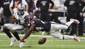 Houston Texans cornerback Johnathan Joseph (24) breaks up a pass intended for Oakland Raiders wide receiver Amari Cooper (89) during the first half of an AFC Wild Card NFL game Saturday, Jan. 7, 2017, in Houston. (AP Photo/Eric Christian Smith)