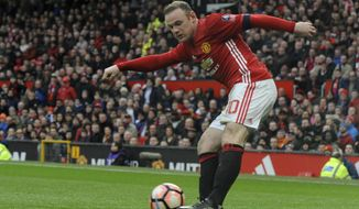 Manchester United's Wayne Rooney shoots at goal during the English FA Cup Third Round match between Manchester United and Reading at Old Trafford in Manchester, England, Saturday, Jan. 7, 2017. United won the match 4-0. (AP Photo/Rui Vieira)