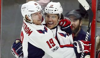 Washington Capitals' T.J. Oshie (77) celebrates his goal with teammate Nicklas Backstrom (19) during first-period NHL hockey game action against the Ottawa Senators in Ottawa, Ontario, Saturday, Jan. 7, 2017. (Fred Chartrand/The Canadian Press via AP)