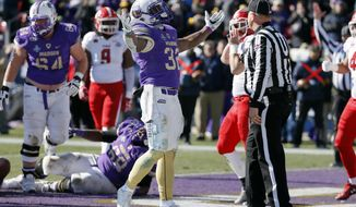 James Madison running back Khalid Abdullah (32) raises his arms in celebration after scoring a touchdown on a running play against Youngstown State in the first half of the FCS championship NCAA college football game, Saturday, Jan. 7, 2017, in Frisco, Texas. (AP Photo/Tony Gutierrez)