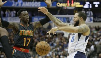 Atlanta Hawks defender Dennis Schroder (17) makes Dallas Mavericks guard Deron Williams (8) lose control of the ball during the first half of an NBA basketball game in Dallas, Saturday, Jan. 7, 2017. (AP Photo/LM Otero)