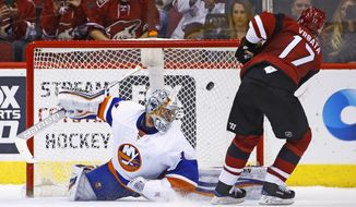 Arizona Coyotes right wing Radim Vrbata (17) scores a goal against New York Islanders goalie Thomas Greiss (1) during the shootout of an NHL hockey game Saturday, Jan. 7, 2017, in Glendale, Ariz. The Coyotes defeated the Islanders 2-1 in a shootout. (AP Photo/Ross D. Franklin)