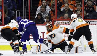 Tampa Bay Lightning's Alex Killorn (17) scores a goal past Philadelphia Flyers' Michal Neuvirth (30) as Andrew MacDonald (47) and Ivan Provorov (9) defend during the second period of an NHL hockey game, Saturday, Jan. 7, 2017, in Philadelphia. (AP Photo/Matt Slocum)
