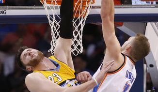 Denver Nuggets center Jusuf Nurkic (23) reaches up to block a shot by Oklahoma City Thunder forward Domantas Sabonis (3) in the first half of an NBA basketball game in Oklahoma City, Saturday, Jan. 7, 2017. (AP Photo/Sue Ogrocki)