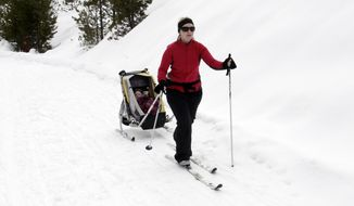 FILE--In this March 2, 2014, file photo, Julie Rau cross-country skis with her daughter, Kaylee, in tow at the Gold Fork Park N' Ski Area near Idaho City, Idaho. Cross-country skiing includes two distinct styles--classic and skate skiing. (Pete Zimowsky/Idaho Statesman via AP, file)